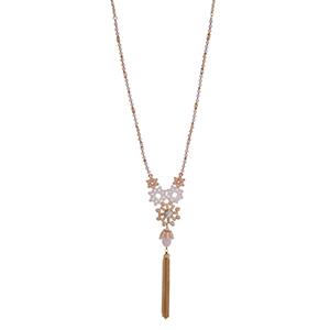 "Gold tone half beaded necklace with pink and peach beads displaying flowers with a rhinestone and hanging chain tassel. Approximately 30"" in length."