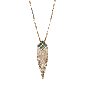 "Gold tone necklace displaying ivory and turquoise bead stations and a diamond shape pendant with chain and beaded fringe. Approximately 30"" in length."