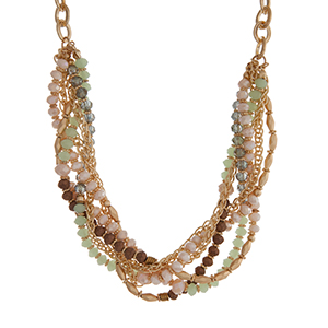 "Gold tone chain link necklace displaying rows of mint, ivory, and brown beads. Approximately 16"" in length."