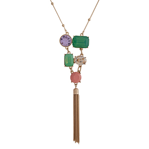 """Gold tone necklace displaying multiple shaped mint, champagne, pink, and clear cabochons with a 2 1/4"""" chain tassel. Approximately 29"""" in length. Overall length 33 1/4""""."""