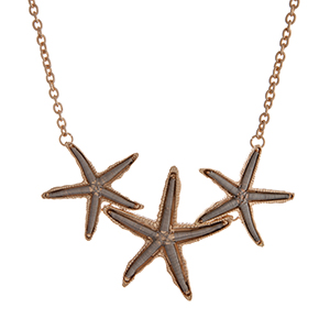 "Two tone necklace displaying three wire wrapped starfish. Approximately 15"" in length."