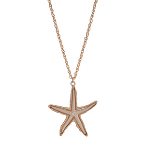 "Gold tone necklace displaying an ivory thread wrapped starfish pendant. Approximately 30"" in length."
