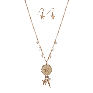 "Gold tone necklace set displaying a pale yellow starfish disk with a cluster of beads, a starfish charm, and a spike. Approximately 18"" in length."