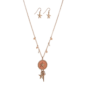 "Gold tone necklace set displaying a peach starfish disk with a cluster of beads, a starfish charm, and a spike. Approximately 18"" in length."