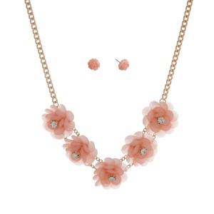 "Gold tone necklace set displaying five pink flowers with rhinestone accents. Approximately 17"" in length."