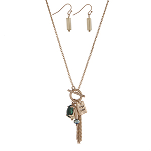 "Gold tone toggle necklace set displaying green stones and beads, a chain mini tassel, and a plate stamped ""True Love"". Approximately 17"" in length."