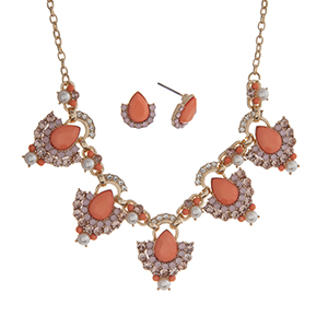 """Gold tone necklace set displaying coral teardrop shape cabochons surrounded by rhinestones and faux pearl accents. Approximately 18"""" in length."""