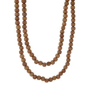 """Long light brown wooden wrap necklace. Approximately 60"""" in length."""
