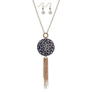 """Gold tone necklace set with a navy blue wooden filigree circle pendant and chain tassel. Approximately 32"""" in length."""