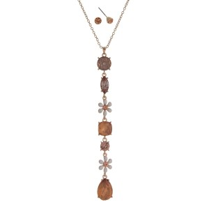 """Gold tone necklace set with a flower and pink opal rhinestone pendant. Approximately 32"""" in length."""