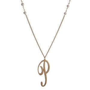 "Gold tone necklace with white pearl beads and a script 'P' initial pendant. Approximately 36"" in length."