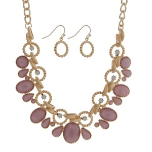 "Gold tone necklace set with pink faceted stones and white opal rhinestones. Approximately 16"" in length."