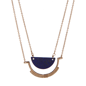 """Gold tone necklace with a half circle navy stone pendant. Approximately 32"""" in length."""