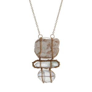 """Gold tone necklace with an ivory, clear and iridescent wire wrapped stone pendant. Approximately 18"""" in length."""