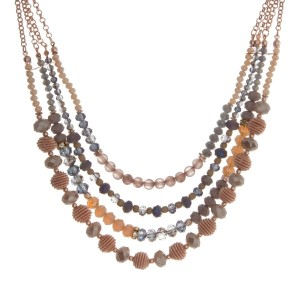 "Rose gold tone triple layer necklace with gray and ivory beads. Approximately 16"" in length."