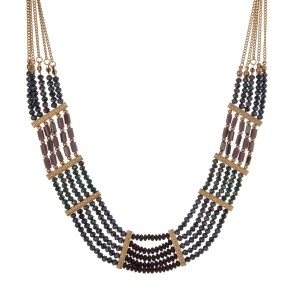 "Gold tone statement necklace with purple, gray, and navy beads. Approximately 18"" in length."
