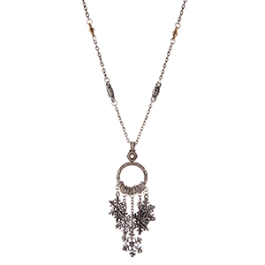 """Silver tone necklace with snowflake charms. Approximately 24"""" in length."""