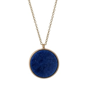 """Gold tone necklace with a reversible blue and gray natural stone circle pendant. Approximately 32"""" in length."""