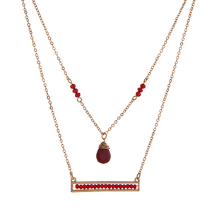 "Dainty double layer necklace with burgundy beads. Approximately 16"" in length."