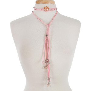 "Pink cord open wrap necklace with a peach stone and silver tone beads. Approximately 80"" in length."