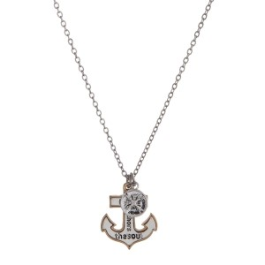 "Dainty two tone necklace with an anchor pendant stamped with ""love anchors the soul"" and nautical charms. Approximately 16"" in length."