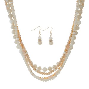 "Gold tone multi-row necklace set with ivory and champagne beads. Approximately 16"" in length."