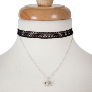 """Double layer silver tone choker necklace with an elephant pendant. Approximately 14"""" in length."""