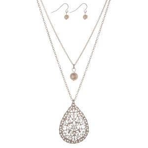 """Silver tone double layer necklace with a pearl bead and a filigree teardrop pendant. Approximately 18"""" in length."""