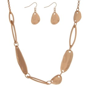 """Gold tone necklace set with hammered gold tone pieces and matching earrings. Approximately 18"""" in length."""