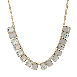 "Gold tone necklace with clear and white opal rhinestones. Approximately 16"" in length."