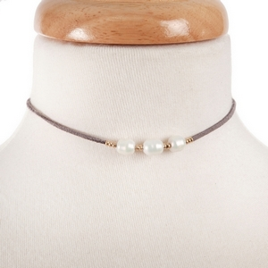 """Gray suede choker with three freshwater pearl beads. Approximately 12"""" in length."""