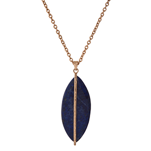 """Gold tone necklace with a sodalite stone pendant. Approximately 32"""" in length."""