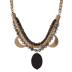 """Gold tone statement necklace with a snake skin pattern, hammered gold tone half circles, gray faceted beads and a black stone pendant. Approximately 16"""" in length."""