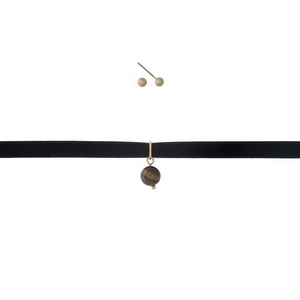 """Gold tone, black velvet choker necklace set with a tiger's eye bead and matching stud earrings. Approximately 12"""" in length."""