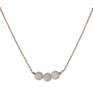"Dainty gold tone necklace with three pearl beads. Approximately 16"" in length."
