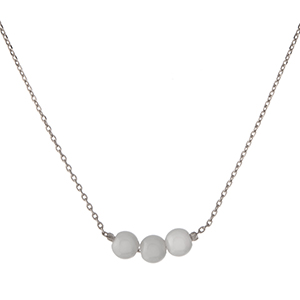 """Dainty silver tone necklace with three pearl beads. Approximately 16"""" in length."""