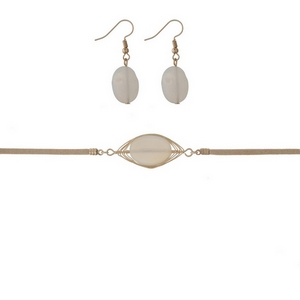 """Tan suede necklace set with a wire wrapped white stone focal. Approximately 16"""" in length."""