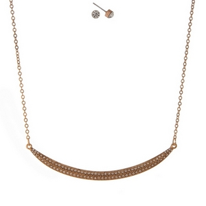 """Rose gold tone necklace set featuring a curved bar pendant, accented with clear rhinestones. Approximately 16"""" in length."""