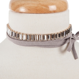 "Gray faux suede wrap choker necklace with clear rectangle rhinestones. Approximately 80"" in length."