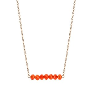 """Gold tone beaded bar necklace with orange faceted beads. Approximately 16"""" in length."""