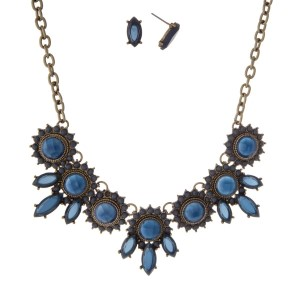 """Burnished gold tone necklace set with navy blue circle and oval stones. Approximately 16"""" in length."""