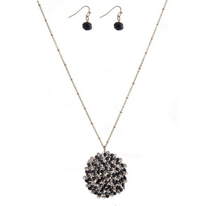 """Gold tone necklace set with a navy and gray beaded circle pendant and matching fishhook earrings. Approximately 24"""" in length."""