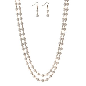 "Gold tone and cream pearl beaded wrap necklace set. Approximately 60"" in length."