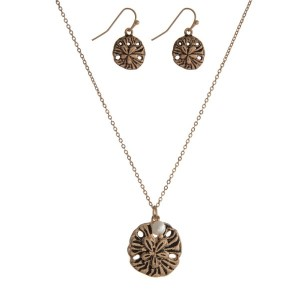 "Gold tone necklace set with a sand dollar pendant and matching fishhook earrings. Approximately 16"" in length."