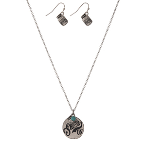 "Dainty silver tone necklace set with a circle pendant stamped with ""Shine On"" and accented with a turquoise bead and matching fishhook earrings. Approximately 16"" in length."