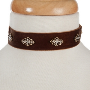 "Brown velvet choker with gold tone accents. Approximately 12"" in length."