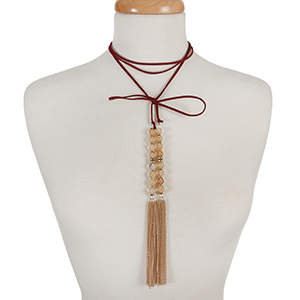 "Burgundy faux suede wrap choker with beige natural stone beads and gold tone chain tassels. Approximately 12"" in length."