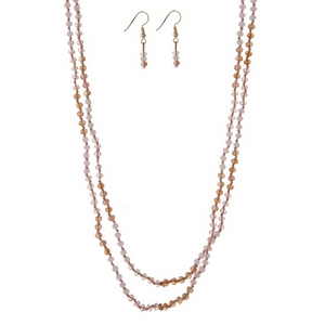 "White opal and champagne wrap necklace with pink and champagne faceted beads. Approximately 60"" in length."