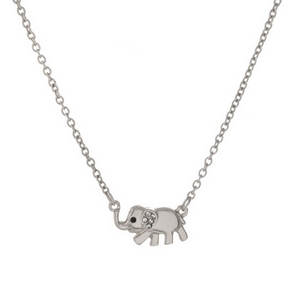 """Dainty silver tone necklace with an elephant pendant, accented with clear rhinestones. Approximately 16"""" in length."""