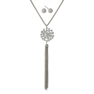 "Silver tone necklace set with a white pearl flower pendant and a chain tassel. Approximately 32"" in length."